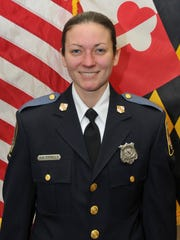 This undated photo made available by the Baltimore County Police and Fire Department Tuesday, May 22, 2018, shows Baltimore County Police officer first class Amy Caprio, who was killed in the line of duty on Monday, May 21, 2018. A 16-year-old boy has been charged with first-degree murder in the slaying of a Caprio, and three other suspects were taken into custody, authorities said Tuesday, May 22, 2018.