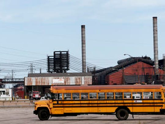 This Sept. 14, 2016 photo shows factories in East Chicago, Ind. The mayor of this industrial town ordered the evacuation of a 40-year-old public housing complex this summer because of severe lead contamination, forcing more than 1,000 people from their homes. (AP Photo/Tae-Gyun Kim)