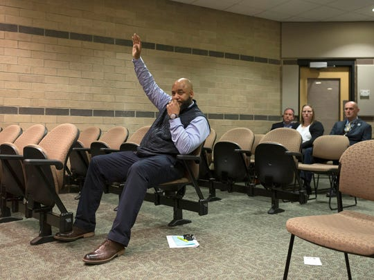 Detroit Police detective and Rochester Hills resident Khary Mason holds his arm up for a question that is never answered during the Rochester Hills City Council meeting on Monday, April 23, 2018, in Rochester Hills.