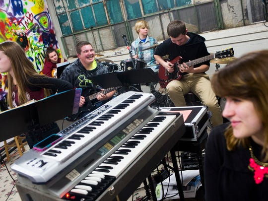 A student band performs during their practice session at the Kalamazoo Academy of Rock in Kalamazoo, Mich. on Wednesday March 4, 2015. Jeff Mitchell teaches rock music to students ages 8-18 throughout the week at the Academy at the former Gibson Guitar Co. factory in Kalamazoo.
