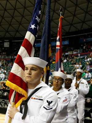 United States Military color guard carries out the flag for the playing of the National Anthem before the Arizona Wildcats play against the Michigan State Spartans Friday at the Stan Sheriff Center in Honolulu, Hawaii.