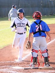 Kody Larm scored four runs against Hot Springs on Tuesday. Above, he trots home in the second inning to tally another score.