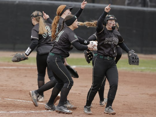 Oshkosh North players celebrate after a Syd Supple