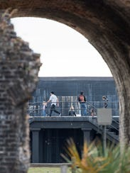 Visitors explore Fort Pickens at the Gulf Islands National