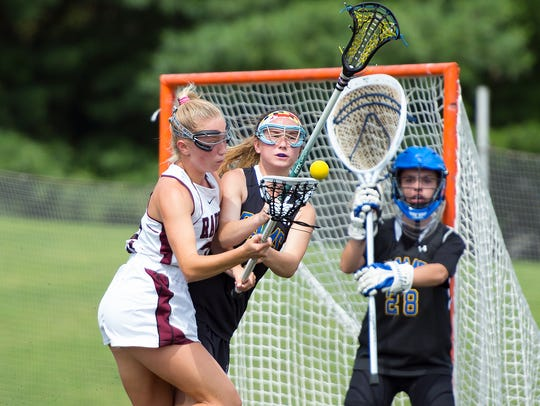 Kennard Dale's Claire Gamache steps in front of Radnor's