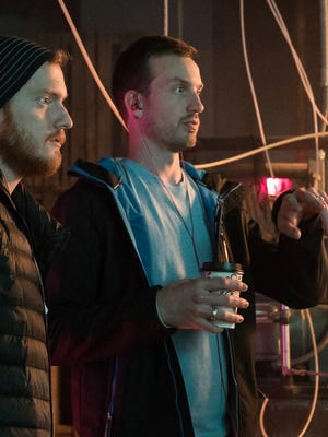 """Bryan Woods, left, and Scott Beck, right, are shown on the set of their upcoming movie """"Haunt."""" Photo courtesy of Mortimer Public Relations."""