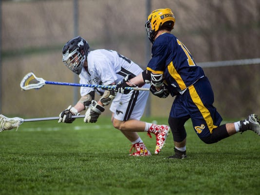 South Western's Anthony DeVincent keeps control of the ball against Eastern York's Sam Pollock on April 16, 2015 at South Western High School. Clare Becker - The Evening Sun