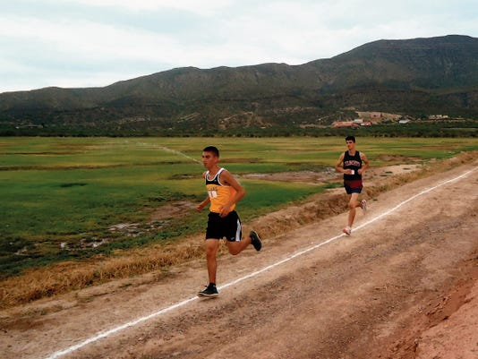 Courtesy Photo   Freshman Wildcat runner Jonathan Chacon, right, led the Deming High junior varsity runners to a second place finish in the team standings Saturday at the Alamogordo Invitational Cross Country Meet. Chacon finished 12th in a time of 21:40 along the 3.1 mile course.