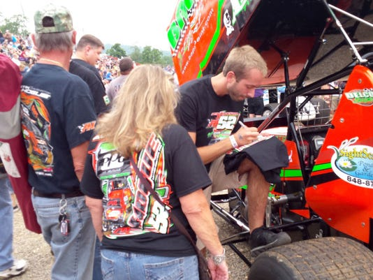 BAPS-sponsored drivers sign autographs last month during a fundraiser for Olivia's House. Another fundraiser is planned for Saturday at Lincoln Speedway.