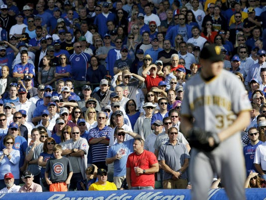 Chicago Cubs fans watch Pittsburgh Pirates closing pitcher Mark Melancon during the ninth inning of Friday's game in Chicago. The Pirates won, 3-2.