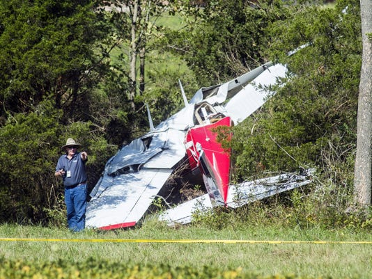 An investigator from the Federal Aviation Administration works at the scene of the plane crash Sept. 19 in Cumberland Township near Black Horse Tavern Road. The crash involved pilot Walter Trostle, 85, who died from head trauma Oct. 27 and passenger Gary Brown, 65, who survived with a fractured wrist.