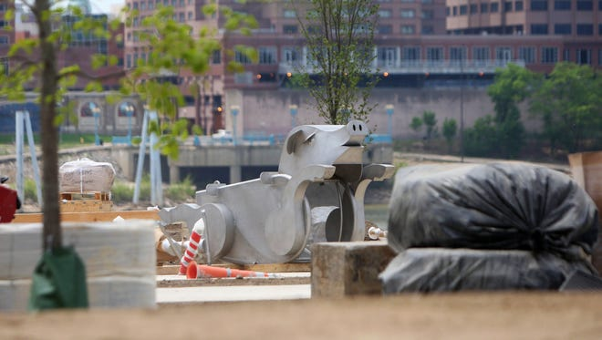 A massive metal flying pig is ready for installation at Smale Riverfront Park's P&G Go VibrantScape, which will include a series of play and exercise features, including a giant foot piano, water pumps and channels. A ribbon cutting and opening is planned for June 4.