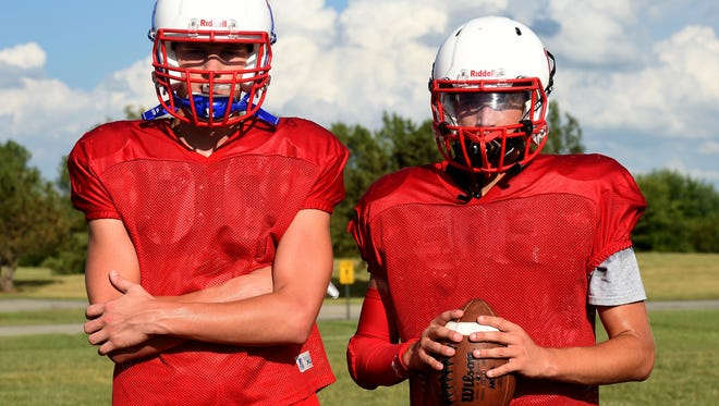 Union County High School football players Cameron Donovan, left, and Caleb Greene during practice Thursday, Aug. 11, 2016 in Liberty.
