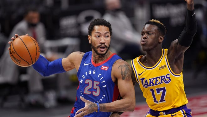Detroit Pistons guard Derrick Rose (25) looks to pass as Los Angeles Lakers guard Dennis Schroder (17) defends during the second half of an NBA basketball game, Thursday, Jan. 28, 2021, in Detroit.