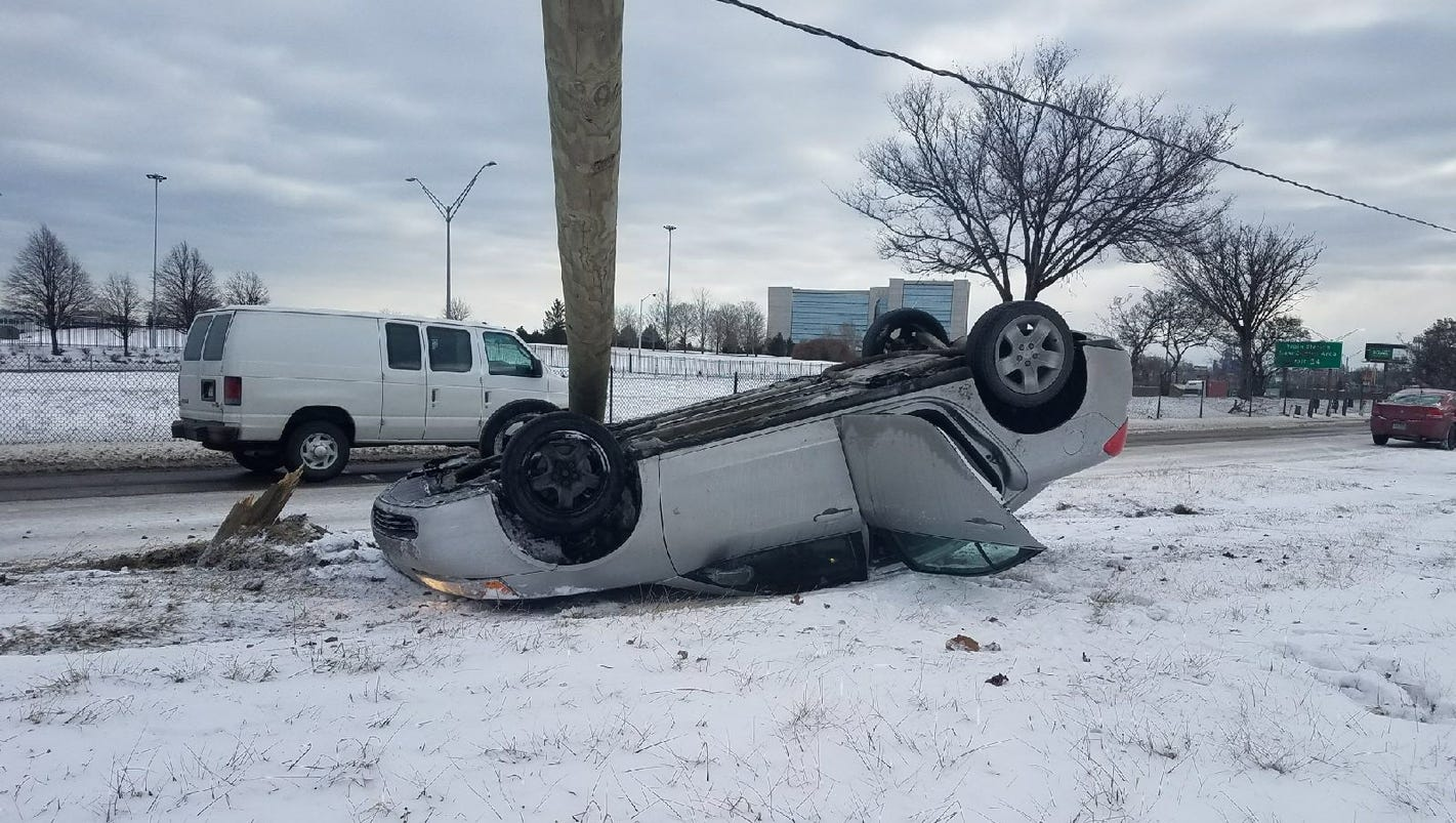 Car flips after hitting light pole; drivers warned to slow down
