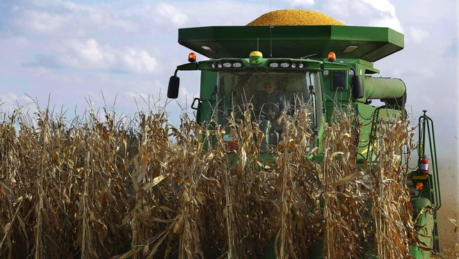 Ethanol groups say farmers are producing more corn on fewer acres, despite what a UW-Madison study claims about cropland shift.