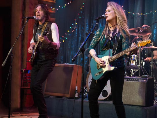 "Rick Springfield, left, and Meryl Streep, as Ricki, perform at the Flash at the Salt Well in ""Ricki and the Flash."""