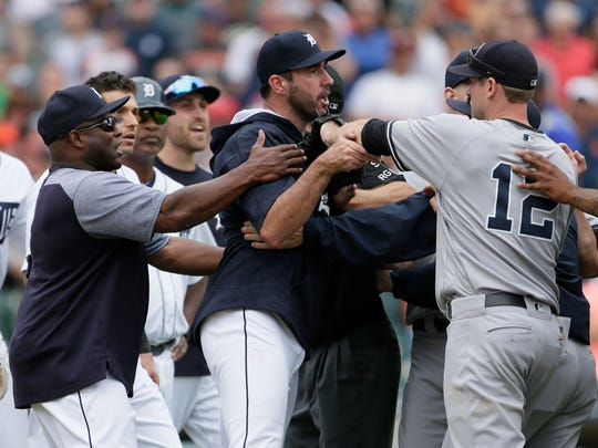 Tigers hitting coach Lloyd McClendon, left, tries to pull Justin Verlander, center, away from Yankees first baseman Chase Headley during the second bench-clearing of the Tigers' 10-6 win over the Yankees on Thursday, Aug. 24, 2017, at Comerica Park.