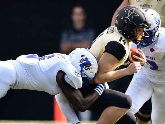 TSU linebacker Christion Abercrombie (6) tackles Vanderbilt