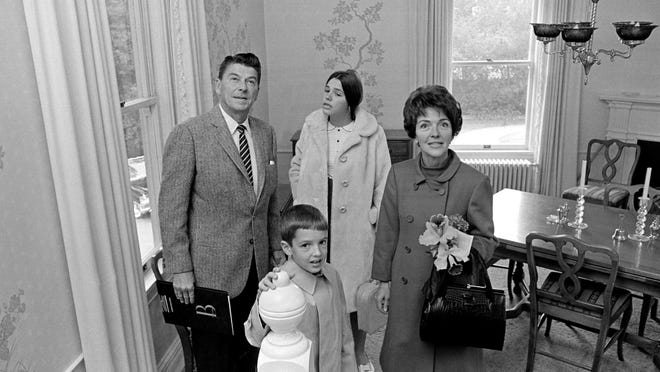 California Gov.-elect Ronald Reagan, his wife, Nancy, and children, Patricia, 13 and Ronald Jr., 8, tour their new home, the Executive Mansion, in Sacramento, Calif.