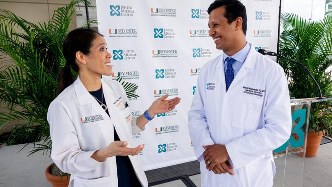 Gynecologic oncologist Dr. Marilyn Huang greets Dr. Shanel Bhagwandin as Jupiter Medical Center announces a new partnership with Sylvester Comprehensive Cancer Center, part of the University of Miami Health System, Wednesday, Feb. 19, 2020, in Jupiter.