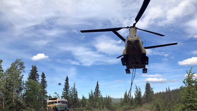 "In this June 18, 2020, file photo released by the Alaska National Guard, Alaska Army National Guard soldiers use a CH-47 Chinook helicopter to remove an abandoned bus, popularized by the book and movie ""Into the Wild,"" out of its location in the Alaska backcountry. The state Department of Natural Resources said Thursday, July 30, that it intends to negotiate with the University of Alaska's Museum of the North in Fairbanks to display the bus."