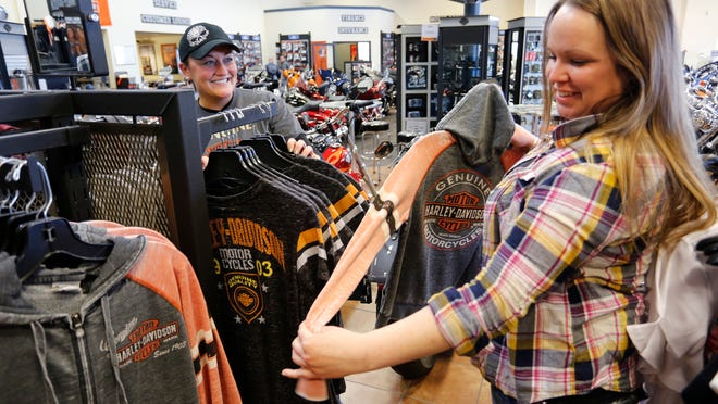Lauren Dufek, left, and Chelsea Miller place  apparel on racks  at Boiler Harley-Davidson, near Frankfort.   Photos by John Terhune/Journal & Courier Lauren Dufek, left, and Chelsea Miller place genuine Harley Davidson apparel on racks Thursday, March 6, 2014, at Boiler Harley Davidson, 1665 S. Clinton County road 800 W near Frankfort. Boiler Haley Davidson purchased Spyke's Harley Davidson in Frankfort, and Eagle Harley Davidson on Navco Drive and will combine the franchises into a state of the art, 36,000 square foot facility off Ind. 26 East near I-65.