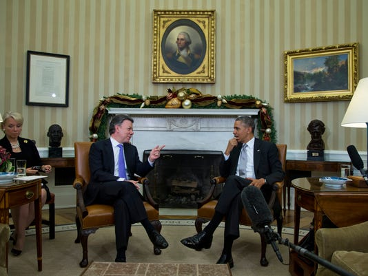 Obama praises peace talks in Colombia
