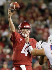 Washington State quarterback Luke Falk (4) throws a pass during the second half of an NCAA college football game against Boise State in Pullman, Wash., Saturday, Sept. 9, 2017. Washington State won 47-44. (AP Photo/Young Kwak)