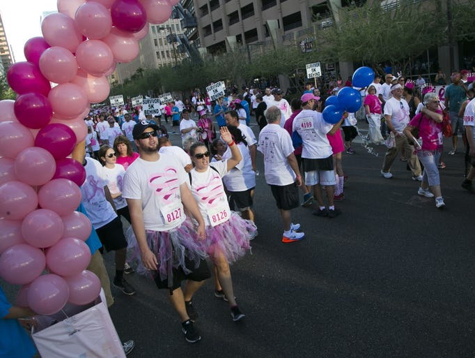 People make their way on the 5k walk during the Phoenix
