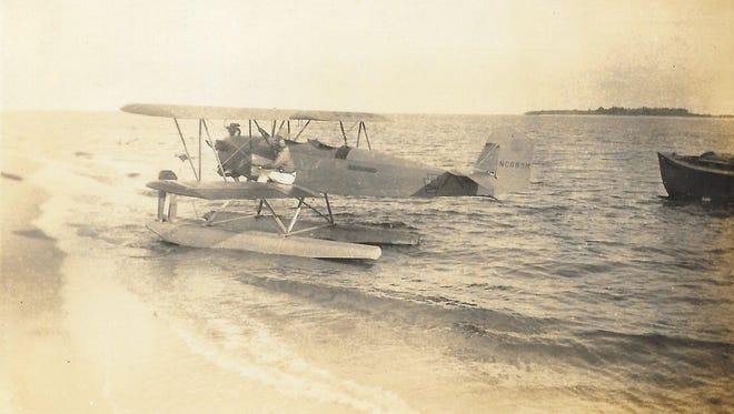 Hugh Willoughby with Bert Krueger in Bert's seaplane, the 1920s.