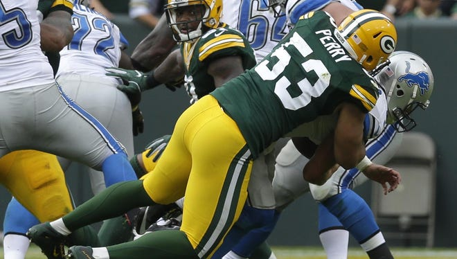 Packers outside linebacker Nick Perry sacks Lions quarterback Matthew Stafford in the fourth quarter of Green Bay's 34-27 win over Detroit last month at Lambeau Field.