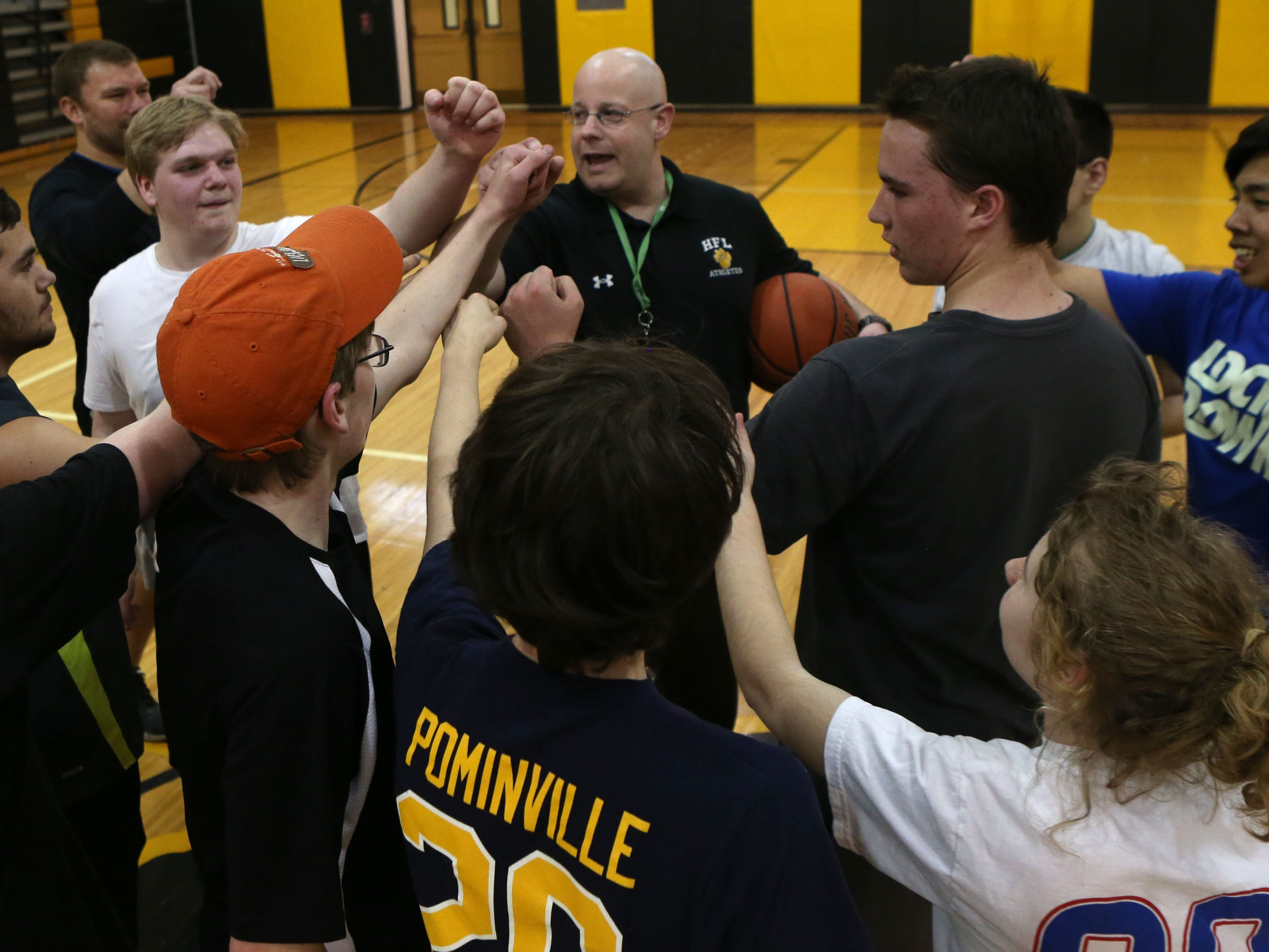 Jim Arrigenna, Adaptive PE Teacher and coach, rallies his team during the second practice for Honeoye Falls-Lima's unified basketball team.