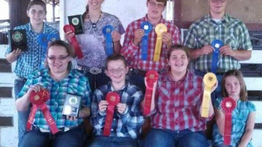 Both the Junior and Senior Livestock Judging Teams judged market and breeding animals in the beef, sheep and swine category at the Area Animal Science Days in Columbia County. From front left,  Junior Team:  Natalie Siedschlag  of Watertown, Riley Kappell of Lebanon, Morgan Wollin of Watertown and Mackenzie Schraufnagel of Beaver Dam.  From back left,  Senior Team:  Paige Wollin of Watertown, Emily Schulz of Iron Ridge, Sam Nehls of Beaver Dam and Jesse  Lynch of Reeseville.
