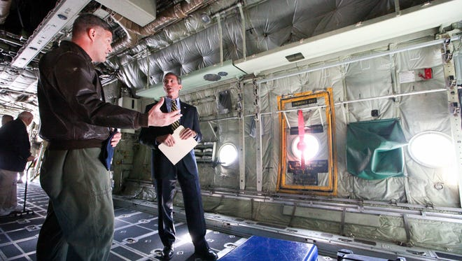 Rep. John Carney, D-Del., talks with Col. Rob Culcasi of the 166th Airlift Wing during a 2014 visit to the New Castle Air National Guard Base to discuss his legislation to modernize the Air Guard's fleet of C-130H2 transport aircraft.