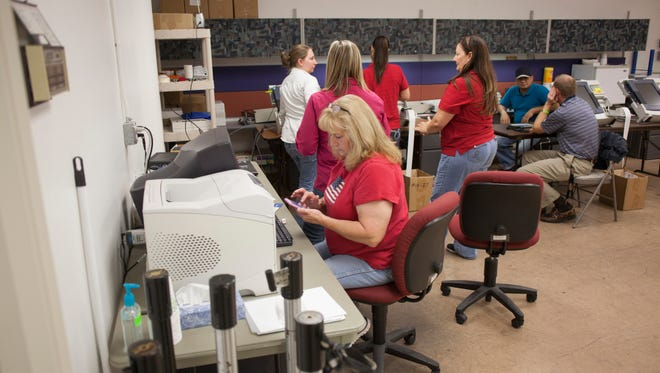 St. George City employees enter voting numbers from precincts throughout the County Tuesday, Nov. 3, 2015.