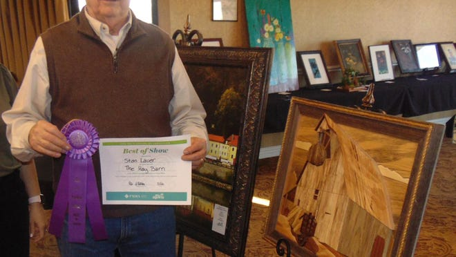 """Stan Lauer, of Salina, won the Art is Ageless masterpiece competition with """"The Hay Barn,"""" a wooden piece that incorporates 11 different kinds of natural woods."""
