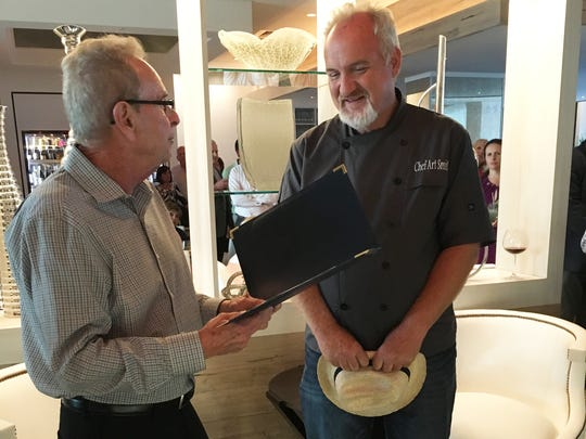 Naples Mayor Bill Barnett presents chef Art Smith with