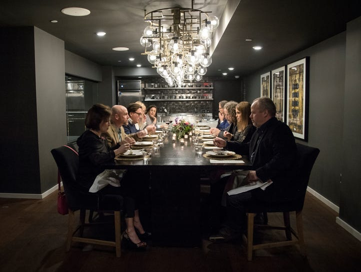 Guests enjoy dinner at the Chef's Table in Detroit