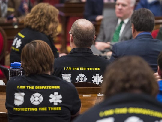 Dispatchers listen as fellow dispatcher Melissa Sharkis (left rear) speaks against a proposal to close two of the four public safety dispatch centers during a public hearing before a joint meeting of the House and Senate Government Operation Committees at the Statehouse in Montpelier on Tuesday, March 17, 2015.
