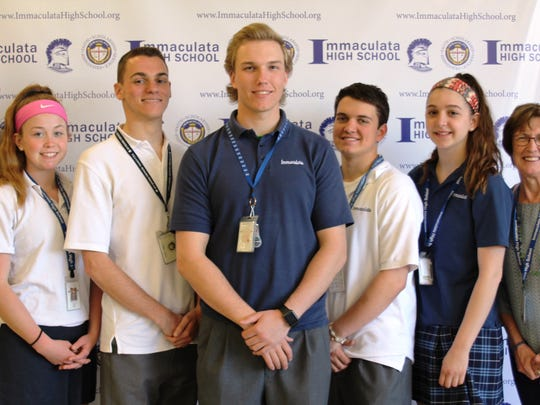 Flanked by AD Tom Gambino on left and Principal Jean Kline on right are Immaculata's 2018 Scholar Athletes. They are from left to right: Skyland Conference Scholar Athletes: Meaghan O'Connor of Branchburg and Matthew Lumia of Hillsborough; NJSIAA Scholar Athlete: Noah Jordan of Hillsborough; Somerset County High School Principals Association Scholar Athletes: Tyler Kojak of Branchburg and Megan Adam of Bridgewater.