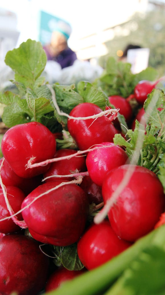 Radishes are for sale in the Gotreaux Family Farms