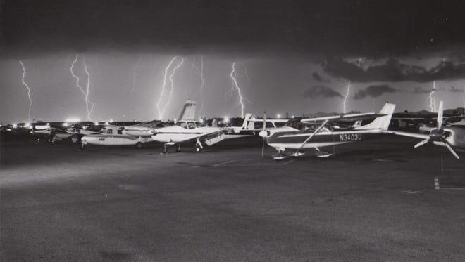 Lightning steaks across the sky behind Sky Harbor March, 15, 1965.