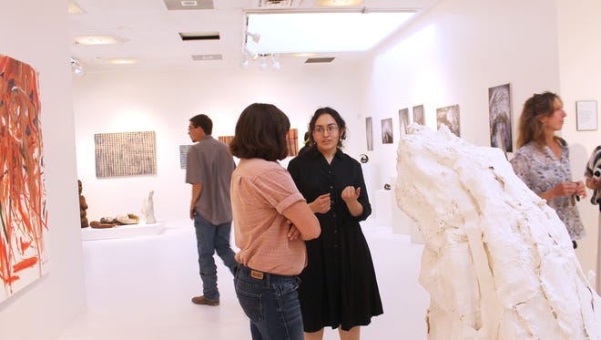 Art student Jennifer Castanon, center, was one of eight graduating WNMU art students featured in an art exhibition. The Graduating Artist Exhibition opening reception was held on Friday.