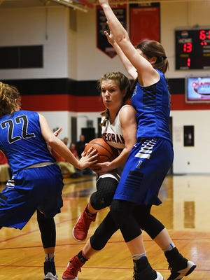 Rosecrans senior Riley Hagy fights her way through the Zanesville defense during their regular season game this past season at Rogge Gymnasium. Hagy earned second-team All-Ohio honors on Monday by the Associated Press.