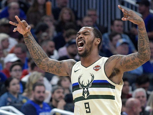 Milwaukee Bucks guard Sean Kilpatrick (9) celebrates after scoring a 3-pointer during the second half of an NBA basketball game against the Orlando Magic Saturday, Feb. 10, 2018, in Orlando, Fla. The Bucks won 111-104. (AP Photo/Phelan M. Ebenhack)