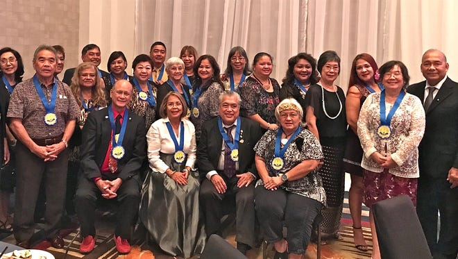 """Members and guests of the Guam Sunshine Lions Club and the Guam Tano-ta Branch Lions Club gathered at the District 204's 25th Anniversary and Cabinet Officers Induction at the Sheraton Laguna Resort on Oct. 8 to celebrate the installation of Lion Danny Cruz, (seated 3rd from left) as First Vice-Governor of Lions Club International District 204. Seated with Cruz left to righ: Lions Dr. John Taitano, President of Guam Tano-ta Branch Lions Club, Rosie Matsunaga, President of Guam Sunshine Lions Club, and Therese """"Ewy"""" Taitano, Region 1 Zone 2 Chairperson."""