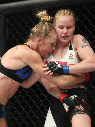 Holly Holm, left, fights Valentina Shevchenko