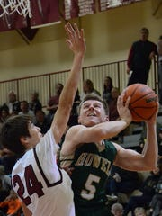 Logan Ward (5) had five points off the bench in the second half for Howell in a 53-51 victory at Milford.