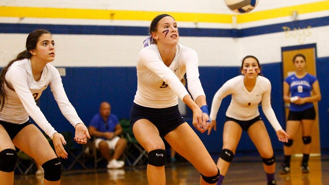 Panas' Yvette Burcescu (5) bumps a serve during the 11th Annual Panther Invitational Volleyball Tournament at Walter Panas High School in Cortlandt Manor on Saturday, September 27, 2014.